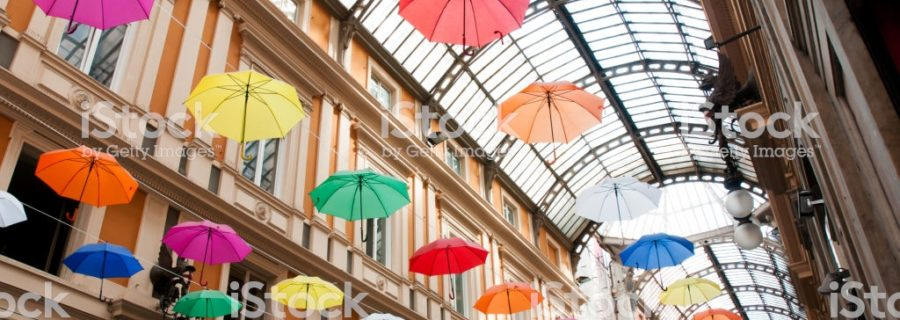 Genoa, Galleria Mazzini decorated with colored umbrellas hanging from its ceiling (event: Euroflora 2018)